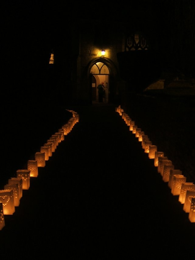 Dscf0522 candles on church path edit